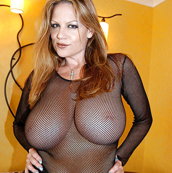 Kelly Madison in fishnet top