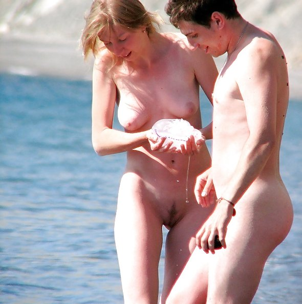 Amateurs sunbathing naked on beach