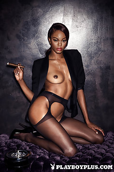 Playboy Playmate Eugena Washington smoking cigar